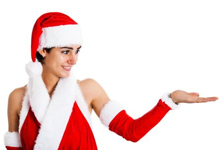 Beautiful girl wearing a Santa Claus dress looking at her empty hand photo