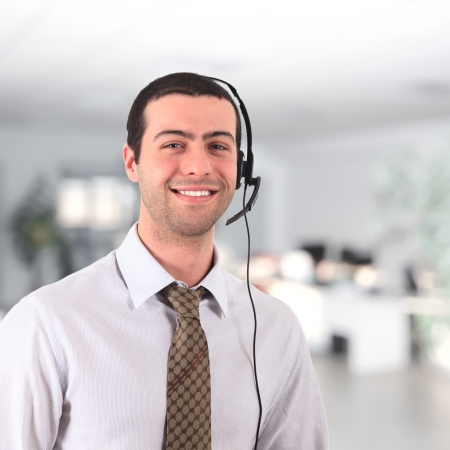 Handsome smiling young man wearing an headset photo