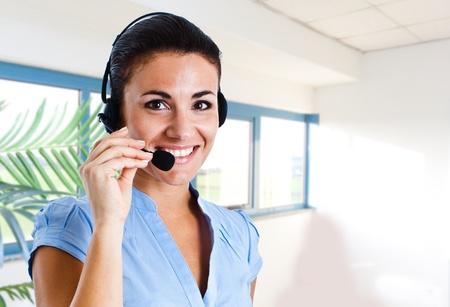 Portrait of a friendly customer representative photo