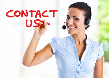 customer service representative: Beautiful woman writing Contact Stock Photo