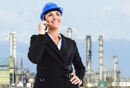 Beautiful engineer talking on the phone photo