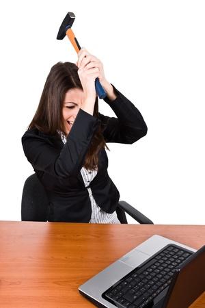 Angry woman smashing her laptop Stock Photo - 14079153
