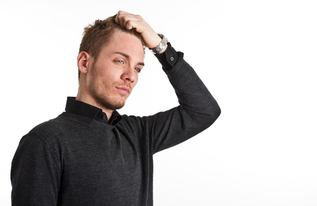 Handsome man touching his hair photo