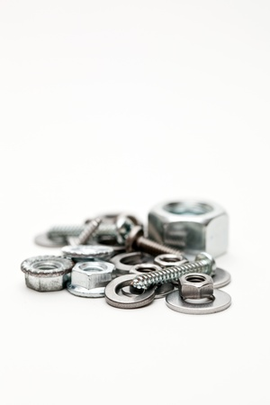 Group of metal nuts and bolts photo