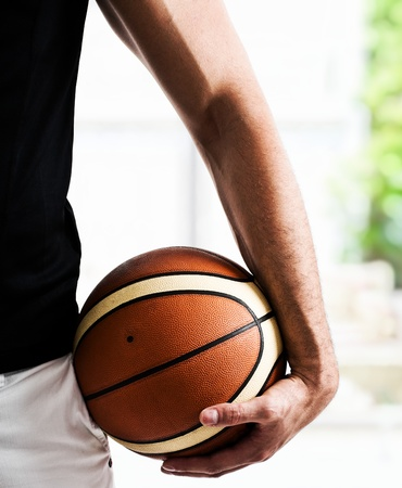 Basketball player holding a basket ball photo
