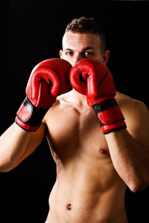 Young boxer portrait  Dark background photo