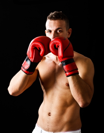 boxing match: Young boxer portrait  Dark background Stock Photo