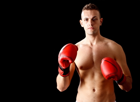 Portrait of an athletic boxer photo