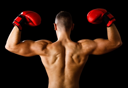 matches: Boxer raising his arms in sign of victory Stock Photo