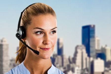 Portrait of a woman using an headset photo