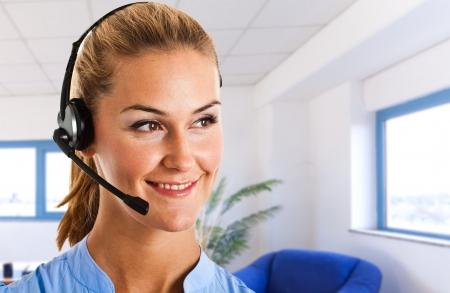 Portrait of a beautiful customer service representative photo