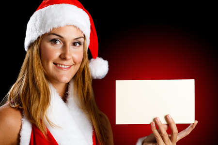 Portrait of a beautiful Christmas girl holding a blank card Stock Photo - 14115531