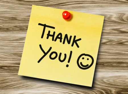 post it notes: Thank you handwritten on a sticky note