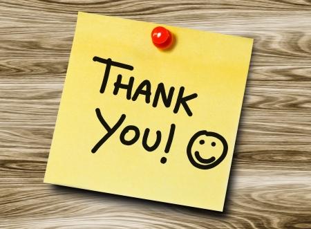 manuscrita: Thank you manuscrita on uma nota pegajosa