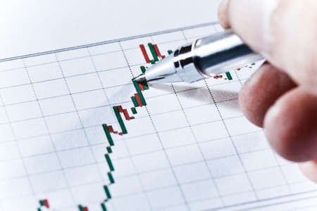 Examination of a stock market report photo
