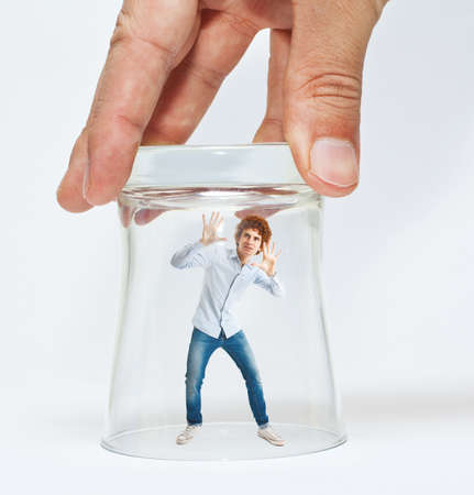 unfair: Young man trying to escape from a glass