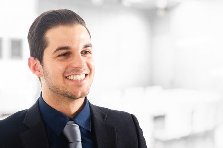 Portrait of a young positive businessman smiling  photo