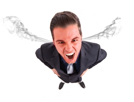 Angry frustrated businessman with exploding head photo