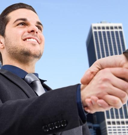 Portrait of businessmen shaking hands Stock Photo - 14317620