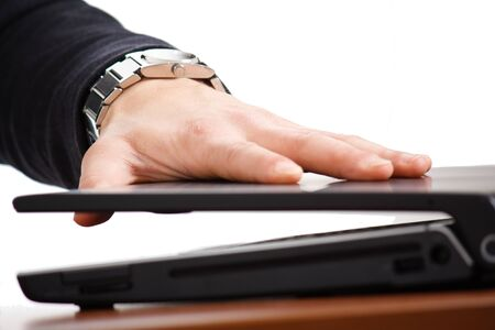 conclude: Businessman closing his notebook.