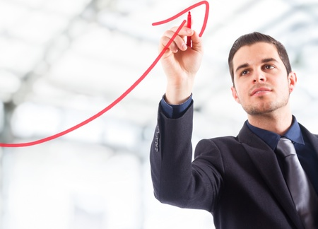 growth in economy: Businessman drawing a rising arrow, representing business growth. Stock Photo