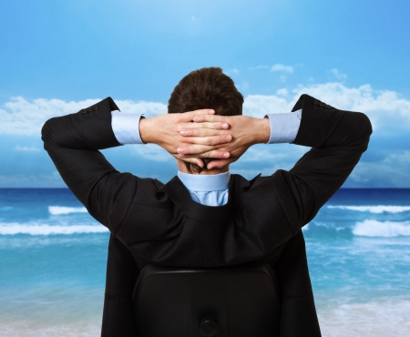 stress management: Businessman relaxing himself on a chair