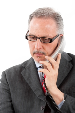 Portrait of a mature businessman speaking at the phone photo