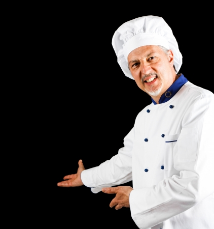 Smiling chef showing something Stock Photo - 14329985