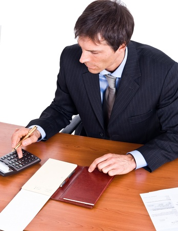 Portrait of a businessman using a calculator photo