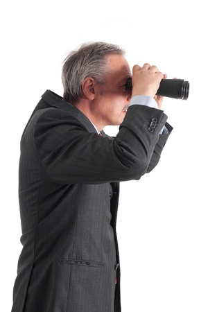 Manager searching for new opportunities using binoculars photo