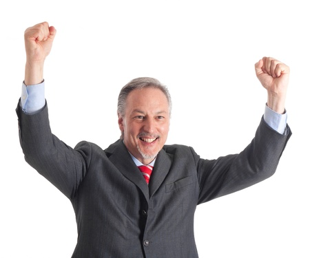 succesful: Portrait of a mature handsome businessman raising arms in sign of victory