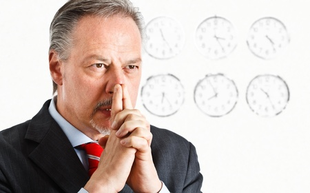 Pensive businessman trying to solve a problem on time Stock Photo - 14330035