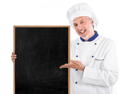 Smiling chef showing an empty blackboard photo