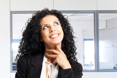 Portrait of a thoughtful businesswoman Stock Photo - 14375392