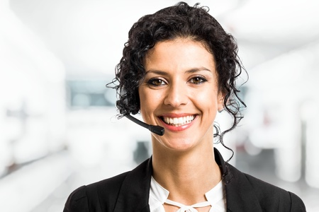 telephone headsets: Portrait of a beautiful customer representative