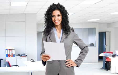 Portrait of a young smiling businesswoman in a office Stock Photo - 14374894