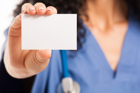 Nurse showing a blank business card photo