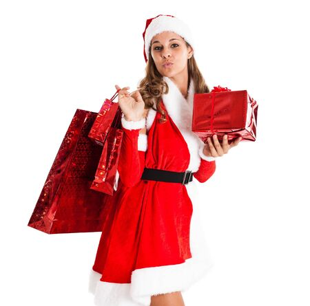 Portrait of a beautiful girl holding presents and gifts photo