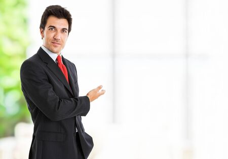 Portrait of a smiling businessman showing the copyspace Stock Photo