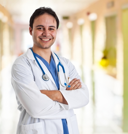 Portrait of a friendly doctor smiling Stock Photo - 14374667