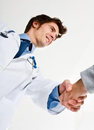 Handsome doctor meeting a patient