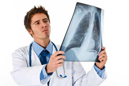 xray: Portrait of a doctor looking at a radiography Stock Photo