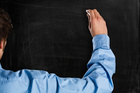 your: Man writing on a empty blackboard  You can add your own text
