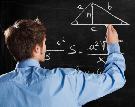 Man writing math formulas on a blackboard photo