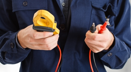 Electrician looking at a tester photo