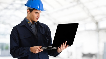 Portrait of an engineer using a laptop Stock Photo - 14374889