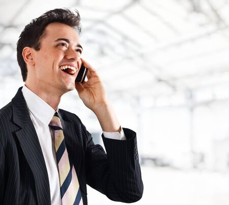 Portrait of a businessman using a cell phone photo