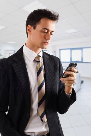 Handsome businessman using a smartphone  Isolated on white photo