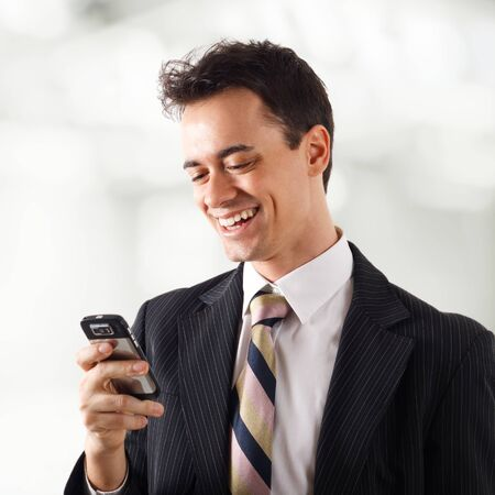 Portrait of a businessman writing a text message photo