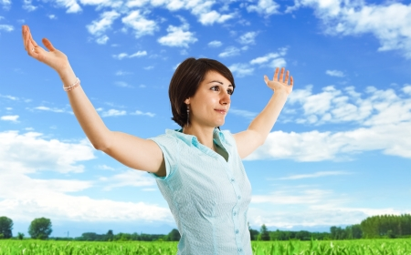 clean air: Woman with arms open having fun and enjoying the nature Stock Photo